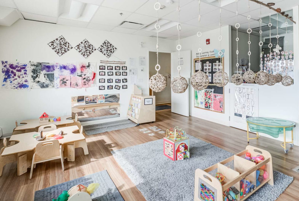 Summerside infant room with various decorations and activities