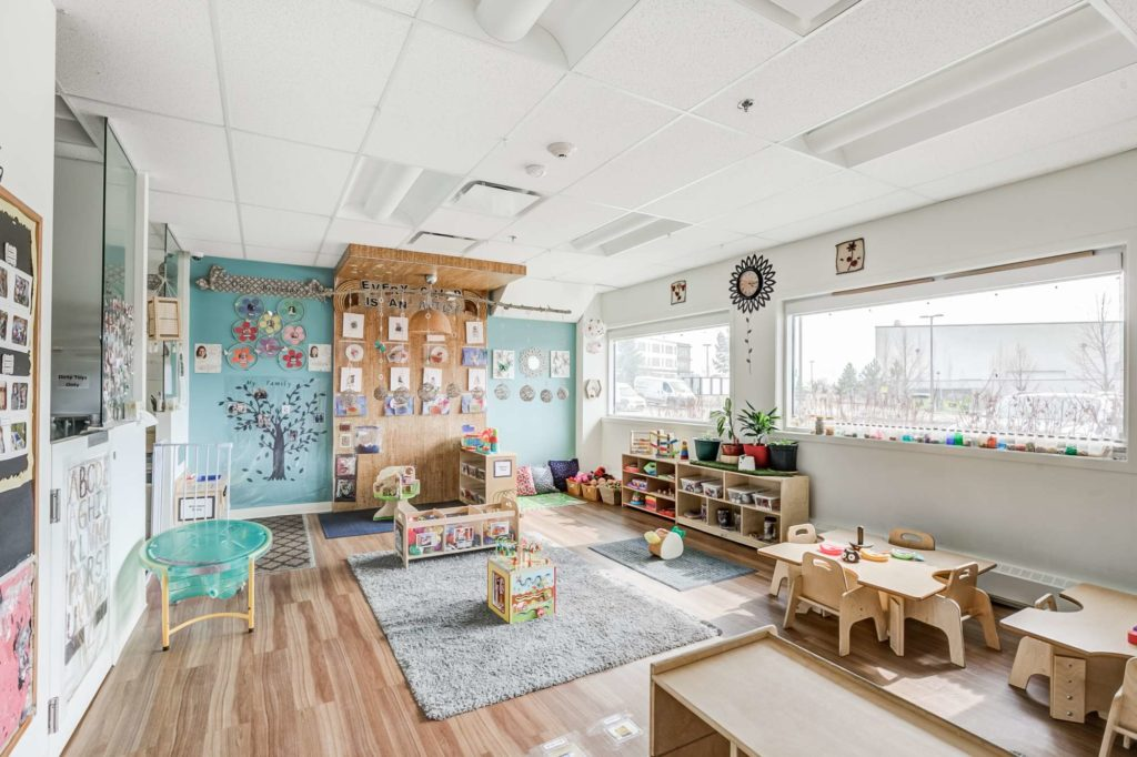 Spacious Summerside infant room with a variety of decorations and engaging acitivities