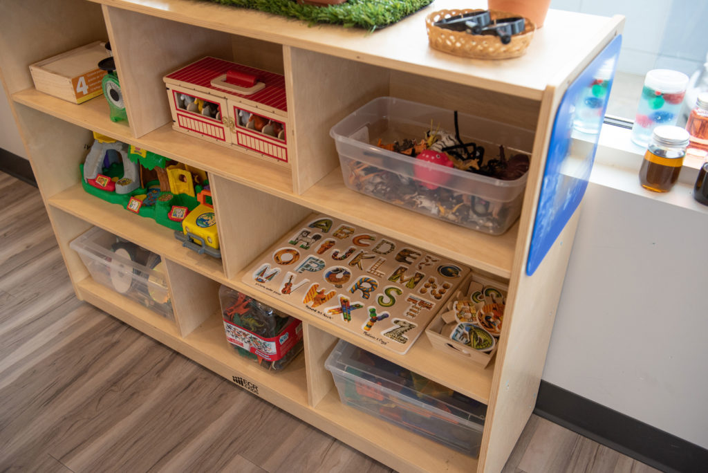 A shelf at the Summerside location filled with a variety of toys for the children to play with.